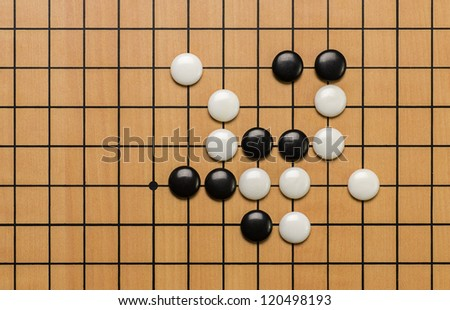 top view on stones on a Go board - stock photo