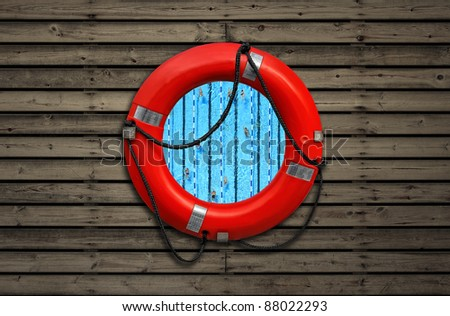 Top view on swimming pool through a red life buoy on a wooden wall