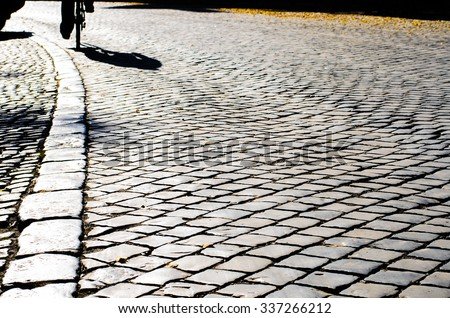 Top view on texture background of straight flat stony brick grey paving stone street road outdoor, horizontal picture