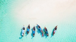 Top view or aerial view of Beautiful crystal clear water and white beach with long tail boats in summer of tropical island or Koh Lipe in Satun,Southern Thailand with copy space