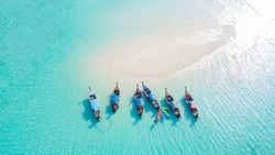 Top view or aerial view of Beautiful crystal clear water and white beach with long tail boats in summer of tropical island or Koh Lipe in Satun,Southern Thailand