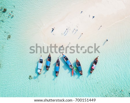 Top view or aerial view of Beautiful crystal clear water and white beach with long tail boats in summer of tropical island named Koh Lipe in Satun,Southern Thailand. #700151449