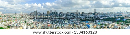 Top view panorama photo from flying drone of a Ho Chi Minh City with development buildings, transportation, energy power infrastructure. Financial and business centers in developed Vietnam.