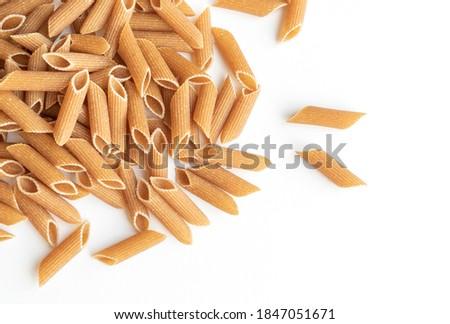 Top view pasta. Whole wheat pasta over white background Foto d'archivio ©
