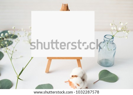 Top view photo. Mockup on a wooden background  with gentle flowers and plants. Cute feminine mockup. Blog header image. Blank space. Card template.