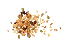 Top view photo of granola pile isolated on white background, muesli texture, scattered seeds pattern, cereal grain for good health