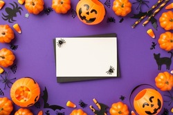 Top view photo of halloween decorations pumpkin baskets candy corn spiders web cat bats silhouettes straws black envelope and white card on isolated violet background with empty space