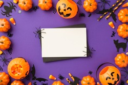 Top view photo of halloween decorations pumpkin baskets candy corn web cat bats silhouettes straws black envelope and spiders on white card on isolated violet background with blank space