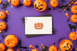 Top view photo of halloween decorations pumpkin baskets candy corn web cat bats silhouettes straws black envelope spiders and orange pumpkin silhouette on white card on isolated violet background