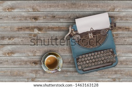 top view photo of vintage typewriter with blank page next to cup of coffee, on wooden table. ストックフォト ©