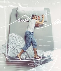Top view photo of young man sleeping in a big white bed. Dreams concept. He dreaming about travel, ship, captain, trip, sea, vacation, tourism, cruise, summer. Painted dream