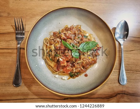 Top View picture of Spaghetti with Spoon and Fork on wood table