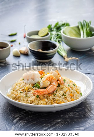 Top view Prawn fried rice served with traditional fish sauce mixed with Thai food, fusion of healthy Thai-Asian food concept