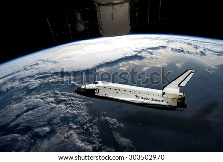 Stock Photo Top view Rockets fly over the air the backdrop parts of the earth. Elements of this image furnished by NASA.