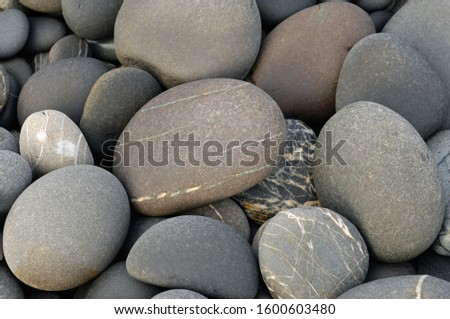 Top view., Sea Pebble beach  Gravel pattern of colored stones. Abstract nature pebbles background. Stone background. Sea Pebble beach