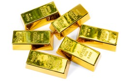 Top view shiny a gold bar 1 kg on white background