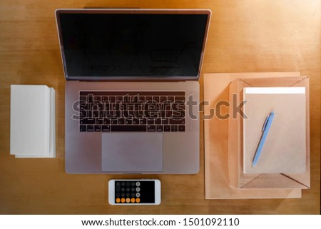 top view, Shipping, online shopping, newcomers, small business owners, trade name on usable receipt, small businesses, SME entrepreneurs or freelance worker. That works with products boxs, calculator