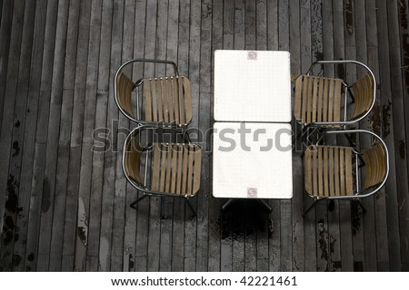 Top view shot of a smoking area with some tables and chairs in a cafe.