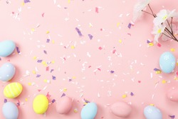 Top view shot of arrangement decoration Happy Easter holiday background concept.Flat lay colorful bunny eggs with accessory ornament on modern beautiful pink paper at office desk.Design pastel tone.