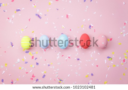 Top view shot of arrangement decoration Happy Easter holiday background concept.Flat lay colorful bunny eggs with accessory ornament on modern beautiful pink paper at office desk.Design pastel tone. - Shutterstock ID 1023102481
