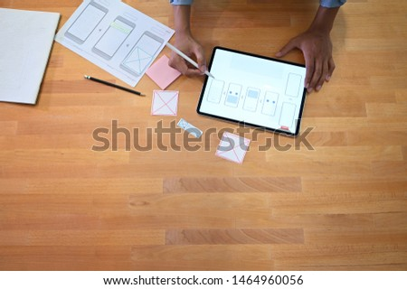 Top view Software developer working with layout paper and digital tablet, UX UI designer. #1464960056