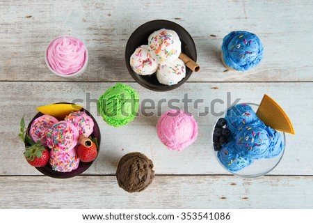 Top view strawberry, blueberry and vanilla ice cream in bowl on white rustic wooden background. #353541086