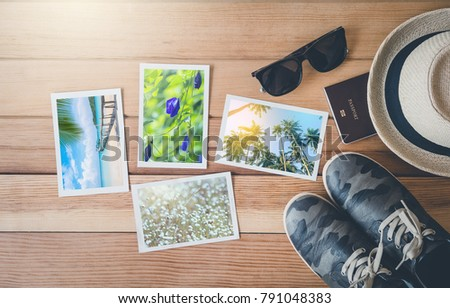 Top view summer photo album on wood table,summer tourism, travel concept.