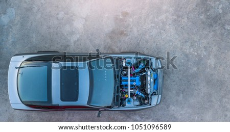 Top view super car engine open up. #1051096589