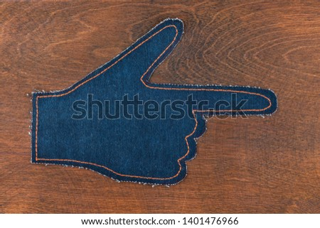 Top view. Symbolic hand pointer made of denim. Copy space. #1401476966