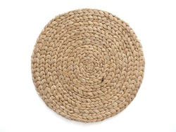 Top view texture of handmade round beige wicker tablecloth surface isolated on white background; Close-up of single oval water mat of water hyacinth fabric. Rustic appearance Heat-resistant.