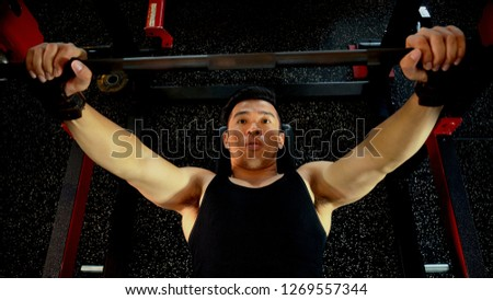 Top view the young athlete man in preparation for workout bench press with a barbell presses in gym for lifting weights, fitness and healthy concept