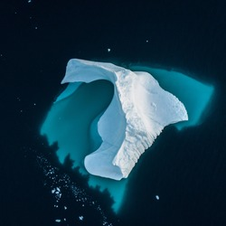 Top view to iceberg. Top and underwater parts of Iceberg. Drone view
