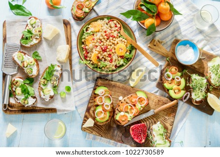Top view vegetarian table with different food. Various vegetarian bruschetta and salad quinoa with chickpeas
