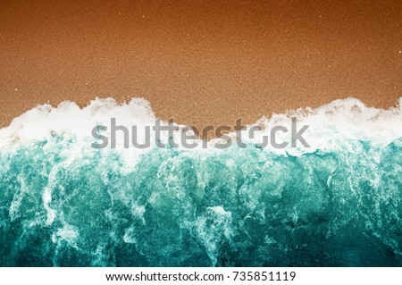 Top View, Wave of Turquoise ocean water on sandy beach, High angle view sea and sand background, Teal color and Dark Brown Wallpaper.