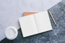 Top view white binder blank notebook or diary or journal for writing text and message with pencil and coffee cup on concrete background with copy space. Business and education concept.