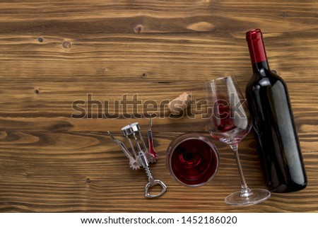 Top view wine bottle with glass on wooden background #1452186020