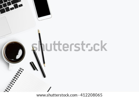 Top view with copy space of white working table with laptop, smartphone, cup of coffee and other supplies.