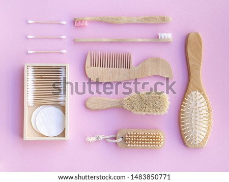 Top view wooden items on pink background