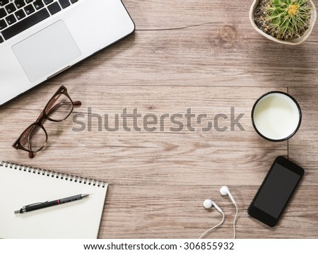 Top view workplace office - Laptop computer,  notebook , smartphone and cup of milk on wooden background ( Space and composition for text ) #306855932