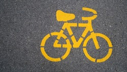 Top - view,Yellow bike symbol on the street in Urban city. transportation concept