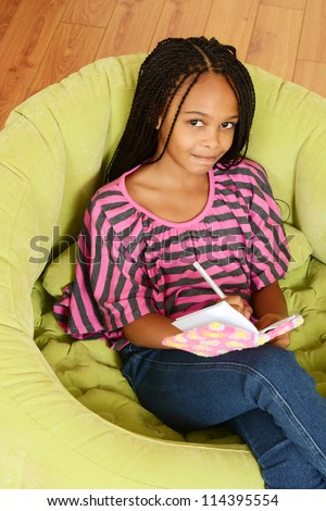 Top view young girl writing in diary