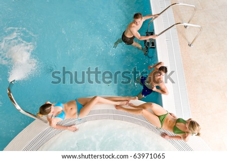 Top view - young people relax in swimming pool at bubble bath
