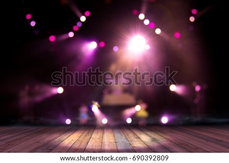 top wood desk with light bokeh in concert blur background,wooden table #690392809