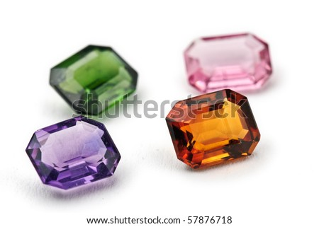 topaz, amethyst and tourmaline Jewels isolated against a white background
