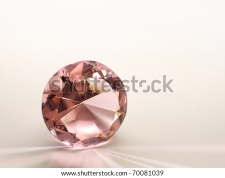 Topaz gemstone diamond shining on light pink background