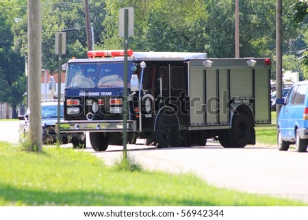 TOPEKA, KS - JULY 10: The Topeka police S.W.A.T. and Hostage Rescue teams respond to a home where a man barricaded himself in his home, threatening harm to himself on July 10, 2010 in Topeka, KS.