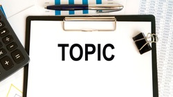 Topic text handwriting on papers with many pencils