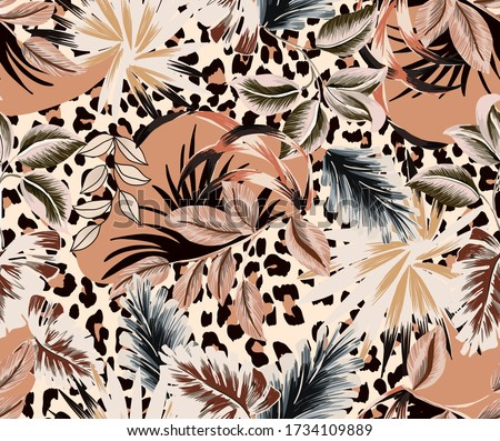 Topical vintage fabric design seamless pattern composed by antique colorful exotic leaves and combined leopard abstract pattern background.