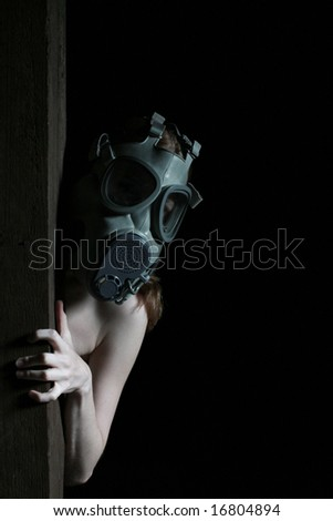 Topless girl in a military gas mask
