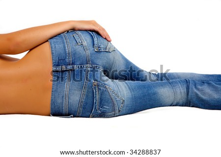 Topless girl in blue jeans laying on the floor - stock photo